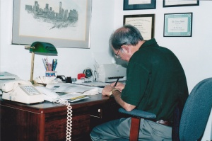 Doug working in his home office